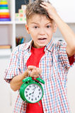 Boy with alarm clock Royalty Free Stock Photos
