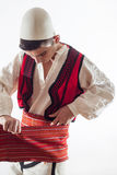 Boy in Albanian traditional costume get dressed Royalty Free Stock Images