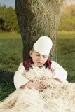 Boy in Albanian traditional costume sleeping at a tree at meadow. Boy in Albanian traditional costume sleeping at a tree stock photos
