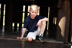 Boy in alcove Royalty Free Stock Photo