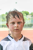Boy is all sweaty after a football match Royalty Free Stock Images