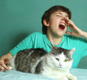 Boy with allergy on cat fur sniff close up photo Stock Photos