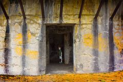 Boy alone in old cave building royalty free stock photos