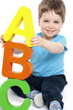 Boy with alphabet Royalty Free Stock Photo