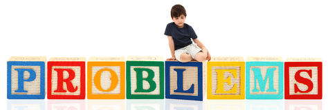 Boy and Alphabet Blocks PROBLEMS Stock Photo