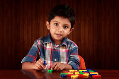 Boy with alphabets Stock Image