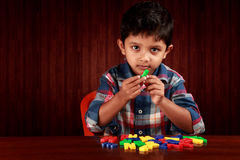 Boy with alphabets royalty free stock photography