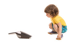 Boy amazed by hand-held vaccum cleaner Royalty Free Stock Photography
