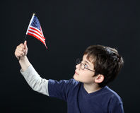 Boy with American flag Royalty Free Stock Photos