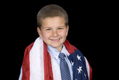 Boy with American flag around shoulders Royalty Free Stock Image