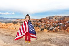 Boy with American flag, Bryce Canyon National Park Stock Photo
