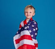 Boy in American flag Stock Photography