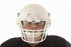Boy in American football helmet. Boy American football helmet and shoulder pads Royalty Free Stock Photography