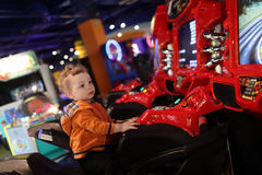 Boy on amusement bike Royalty Free Stock Photography