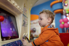 Boy and amusement machine Stock Image
