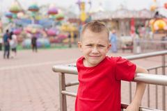 Boy in the amusement park Royalty Free Stock Photo