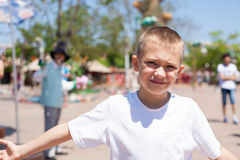 Boy at an amusement park Royalty Free Stock Photography