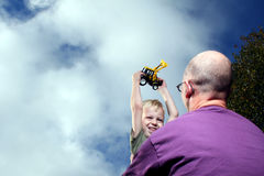 Boy And Dad With Truck Stock Image