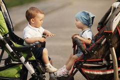 Boy And Girl In Baby Carriages Royalty Free Stock Photography