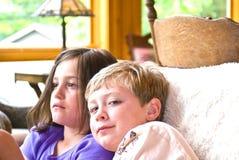 Boy And Girl On Sofa Stock Photo