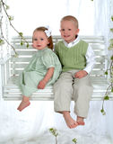 Boy And Girl On Swing Royalty Free Stock Photography