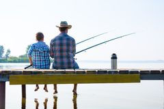 Boy And His Father Fishing Togethe Stock Photos
