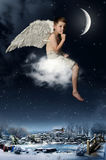 The boy-angel. Flies on a cloud at Christmas night Royalty Free Stock Photography