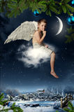 The boy-angel. Flies on a cloud at Christmas night Royalty Free Stock Photos