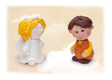 Boy and angel figure Royalty Free Stock Image