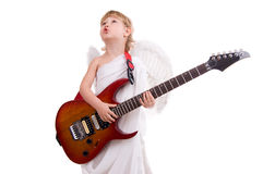 A boy angel plays guitar and sings Royalty Free Stock Images