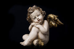 Boy angel sculpture. On black background Stock Photography