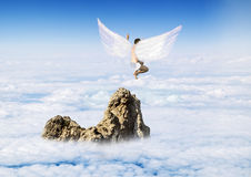 Boy with Angel Wings flying around in the sky Stock Photos