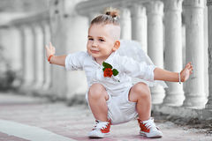 Boy with angel wings on old city background Stock Photo