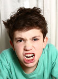 Boy in anger rage emotional closeup portrait Royalty Free Stock Photo