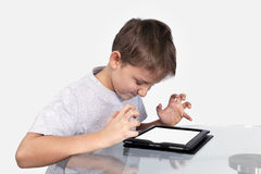 The boy is angry over the Tablet PC Stock Images