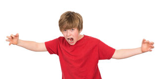 Boy is angry. Boy in red shirt is angry royalty free stock image