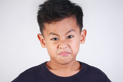 Boy Angry and Resentful. Portrait of young Asian boy getting angry and resentful Royalty Free Stock Photography