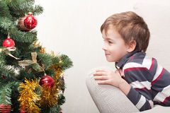 Boy in anticipation of  holiday Royalty Free Stock Images