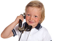 Boy with antique telephone Royalty Free Stock Image