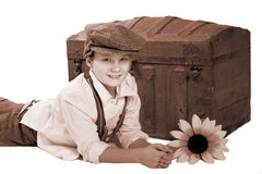 Boy and antique trunk Royalty Free Stock Photography