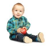 Boy with apple Stock Photos
