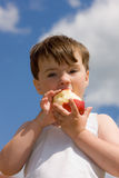 The boy with an apple Royalty Free Stock Images