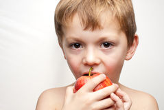 Boy with an apple Stock Image