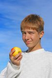 Boy and apple Stock Photography