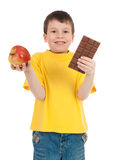 Boy with apple and chocolate Stock Photo