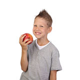 Boy with apple in hand. Joyful teenage boy with wide smile holds big red apple in hand isolated on white background is square Royalty Free Stock Photo