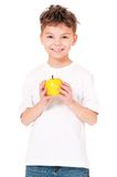 Boy with apple Stock Images