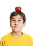 Boy with apple on his head Stock Image