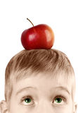 Boy with an apple on his head Royalty Free Stock Photos