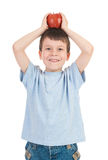 Boy with apple on his head. Isolated Royalty Free Stock Image